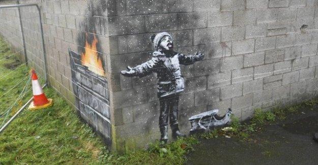 Nouveau Graffiti dans le pays de Galles: voeux de noël de Banksy