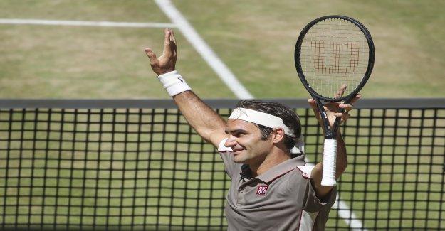 Roger Federer, qui aide l'Enseigne Uniqlo pas Auschwung - Vue